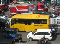 A school bus and fire truck crawl through traffic in Jakarta. The Indonesian government believes unplanned growth has led to urban chaos (Gunawan Kartapranata/CC BY-SA 4.0)