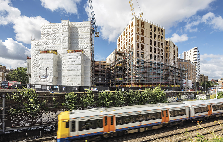 The lightness of CLT allowed Dalston Works to be built over Crossrail