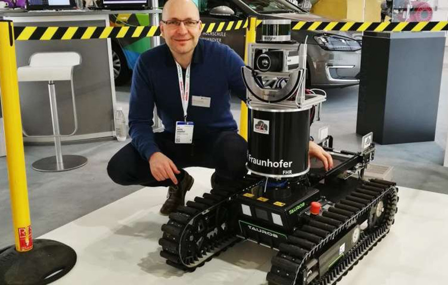Image: Professor Lilienthal and the latest prototype of the SmokeBot (Örebro University)