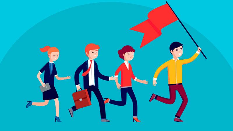 Líder segurando uma bandeira e motivando três colegas de equipe que o estão seguindo