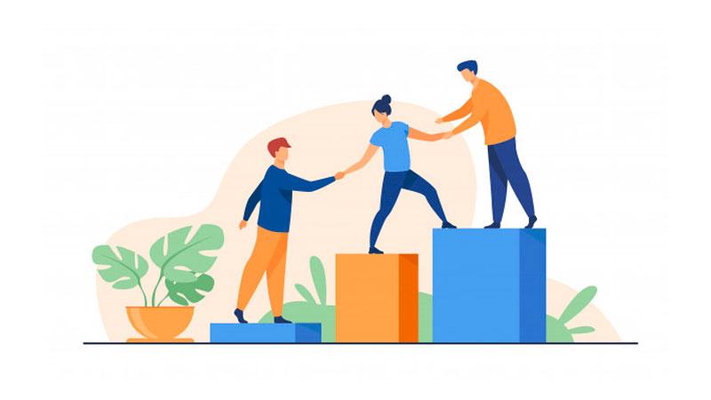 Líder auxiliando sua equipe a superar obstáculos