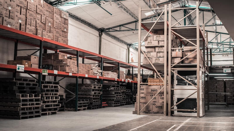 THe image shows a warehouse with several packages