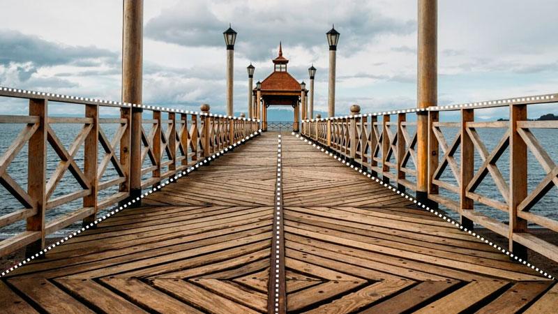 foto de um pier com as linhas destacadas guiando a atenção ao ponto central