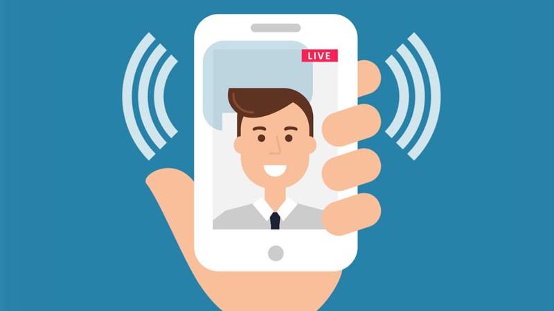 Ilustração de uma mão segurando um celular fazendo uma transmissão ao vivo pelo Instagram.