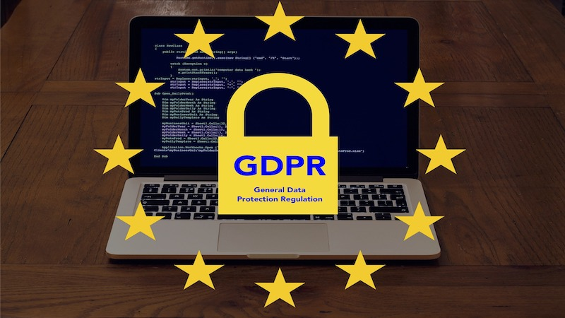"""The image shows a laptop on the backgroung, and in the front there is a lock, where it's written 'GDPR General Data Protection Regulation"""""""