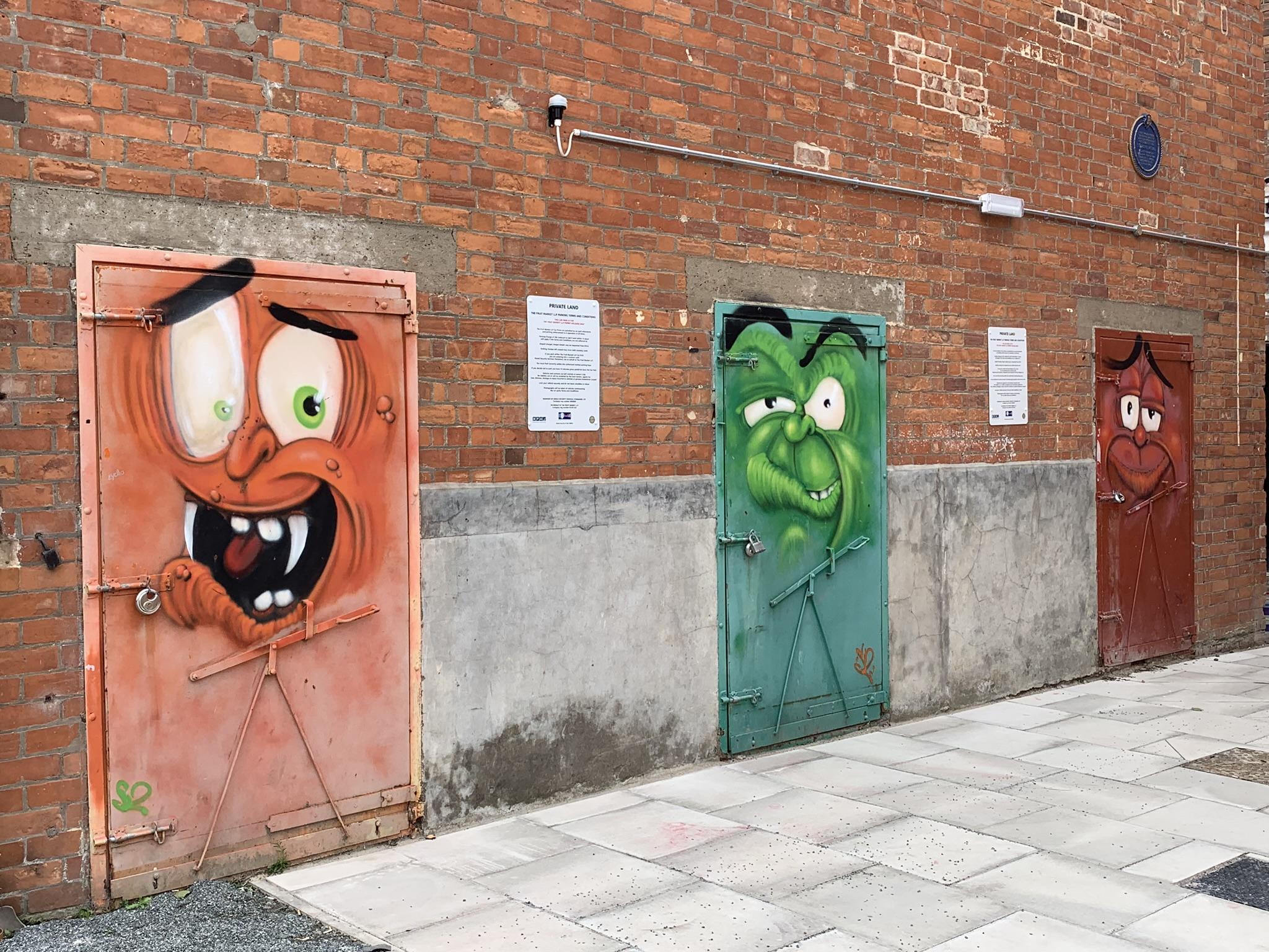 Street mural painting on doors in Hull