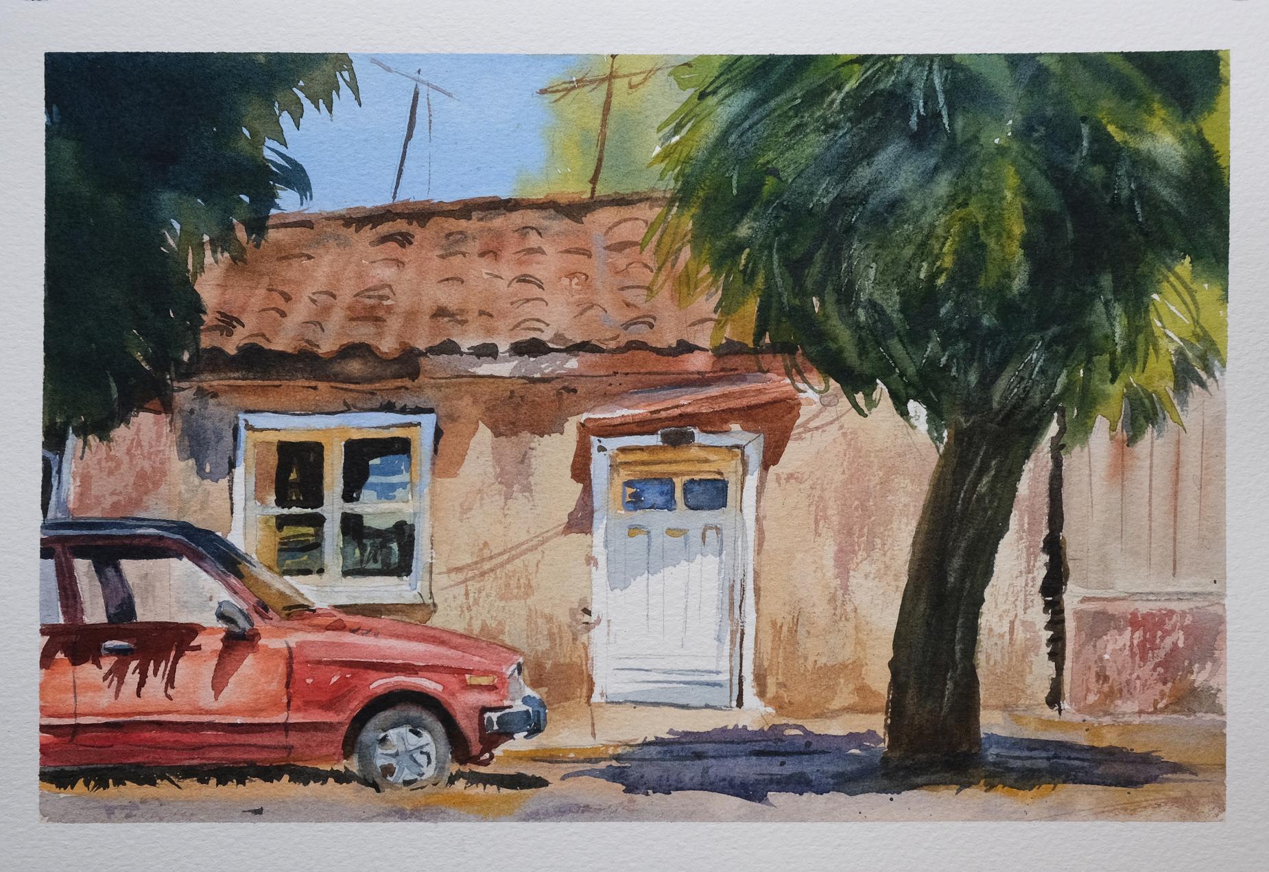 Watercolour painting of a house and car.
