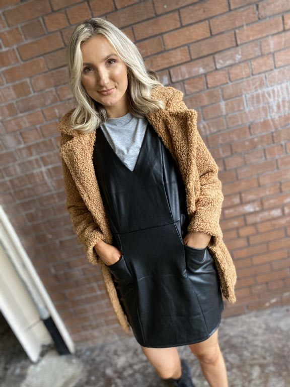 Faux leasther pinafore, £32, Teddy coat £59.99 both Dorothy Perkins