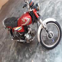 Honda CD 70 cc bike red color