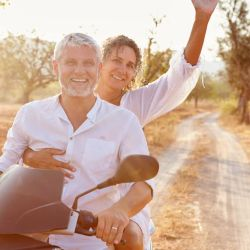 Annual multi-trip travel insurance: Saving you time and money: Middle age couple on bike
