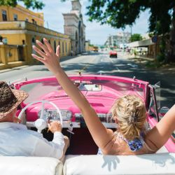 Medical Conditions That Prevent You From Flying: Couple driving in Cuba