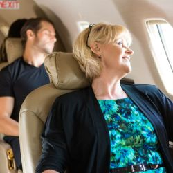 When you can fly after having DVT: Middle age woman looking out of plane window