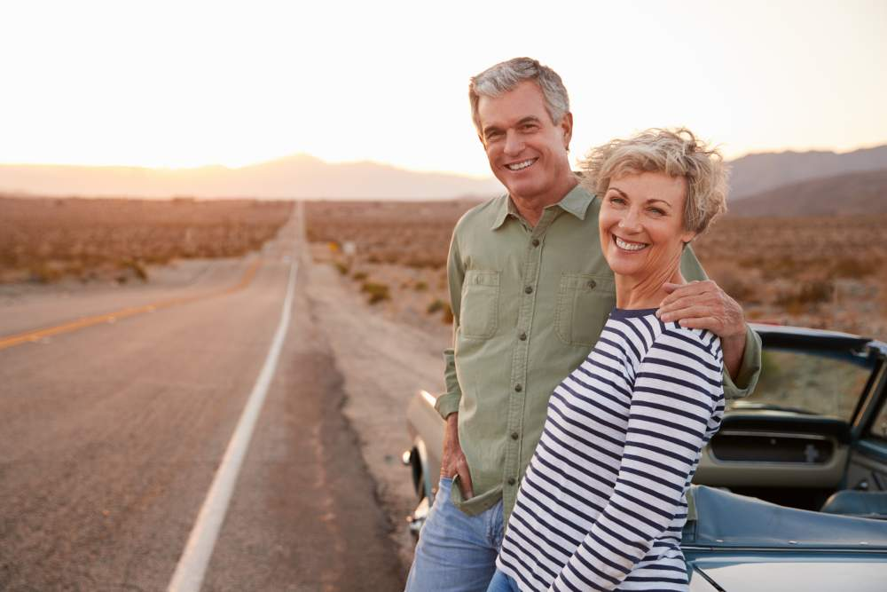 A Guide to Insurance When Airlines or Travel Companies Go Bust: Middle aged happy couple on route 66