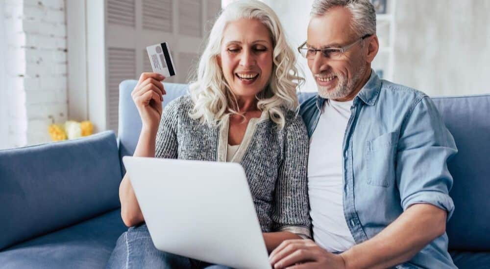 Couple Thinking About The Pros and Cons of Travel Reward Cards | AllClear Travel Blog