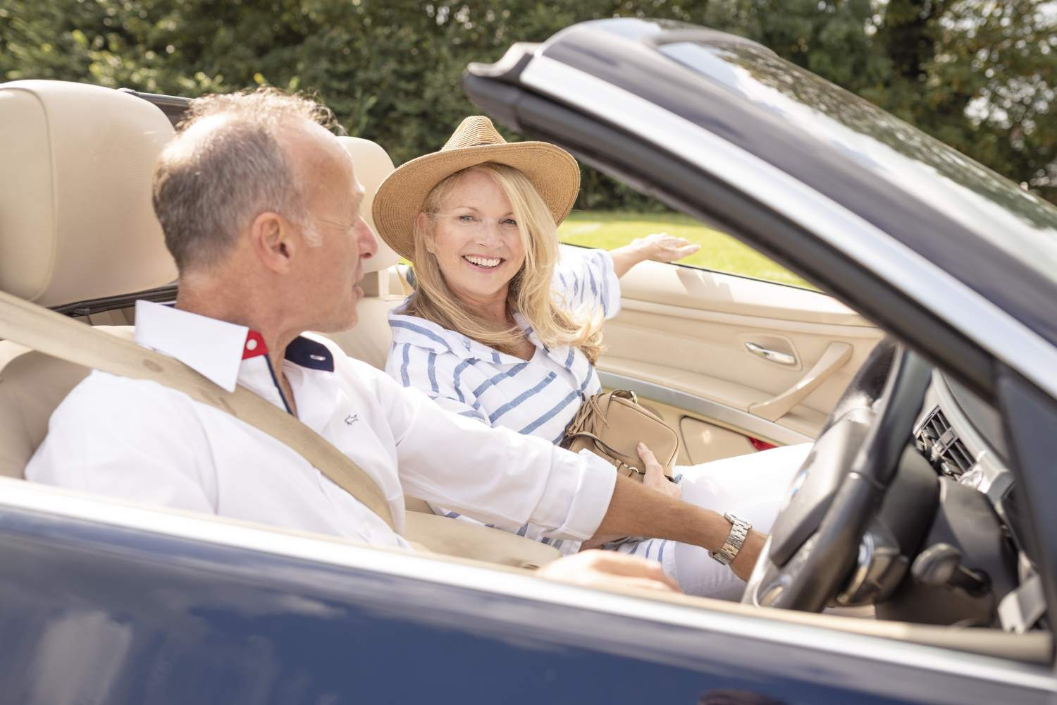 Happy middle aged couple on a road trip as Money Saving Expert Martin Lewis Makes 2020 Travel Insurance Plea
