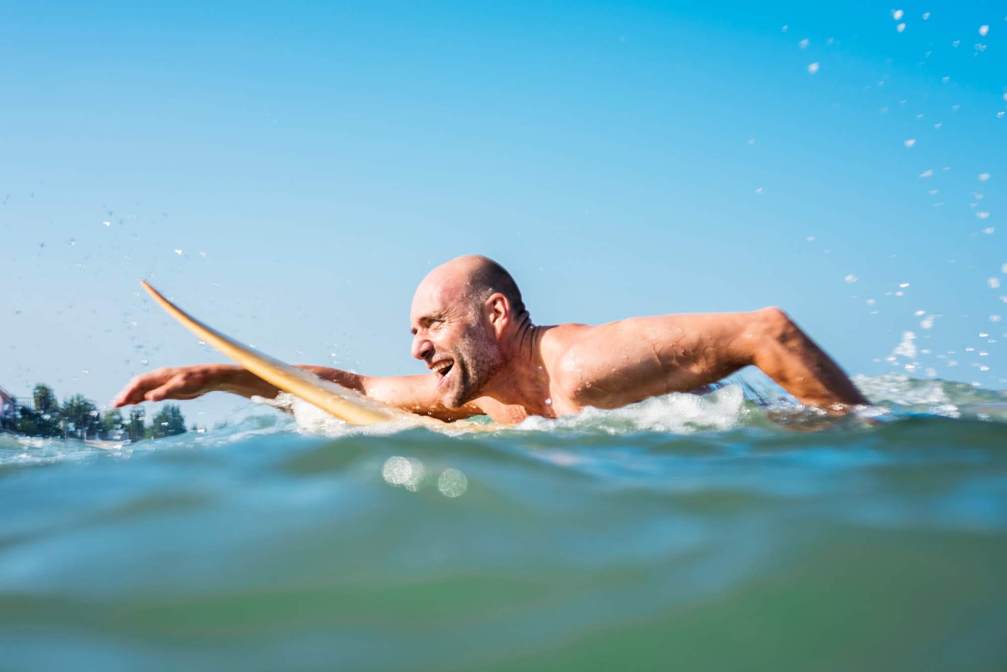Middle aged man swimming in the ocean as New Research Reveals the Truth About Ageing