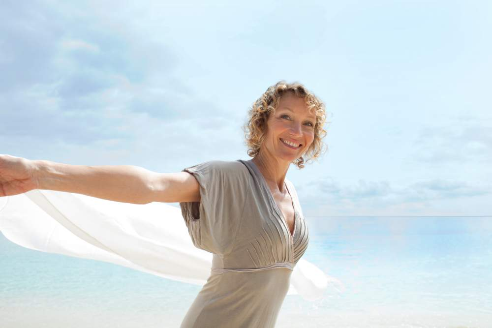 Living with a Stroke: mature woman on holiday by the sea