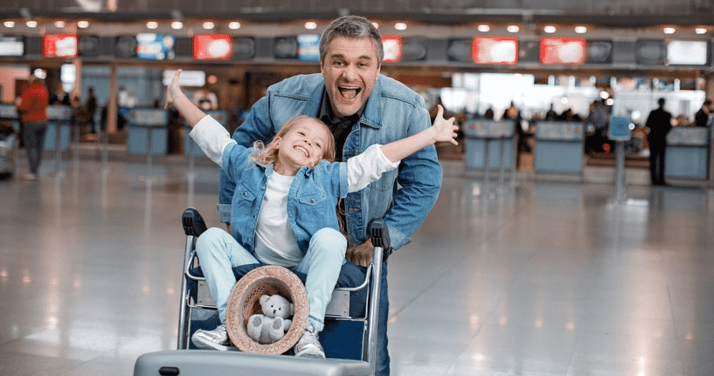 Man and a child at the airport