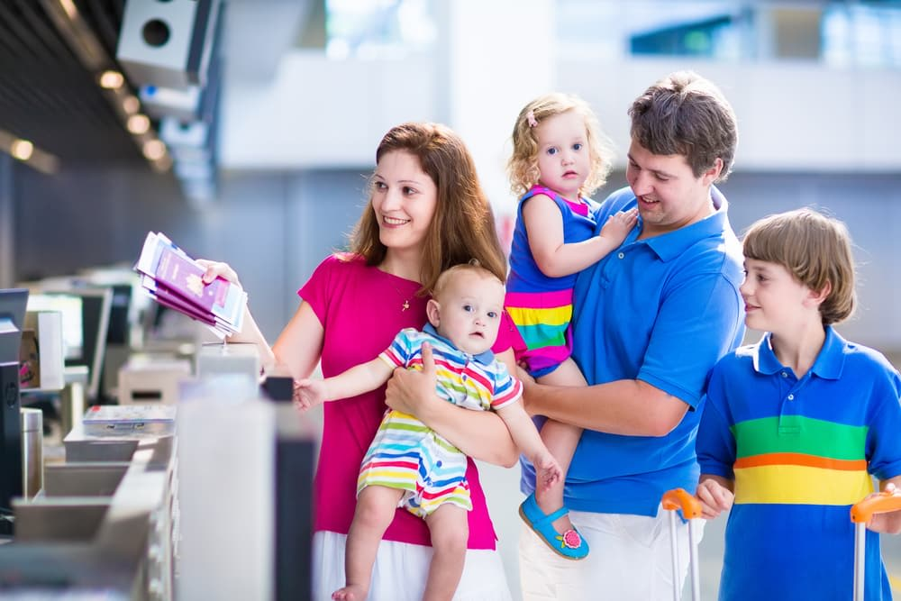 Travelling With Medications | Hand Luggage Restrictions: How to pack your hand luggage: Family showing passports at airport