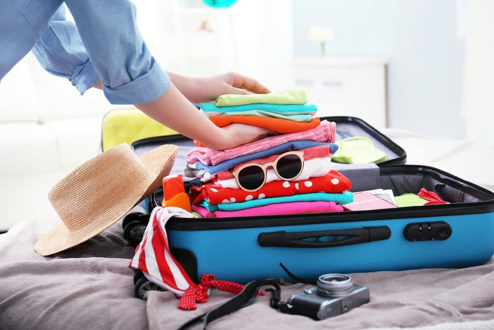 Preparing for a holiday when you have a medical condition: A woman packing her suitcase