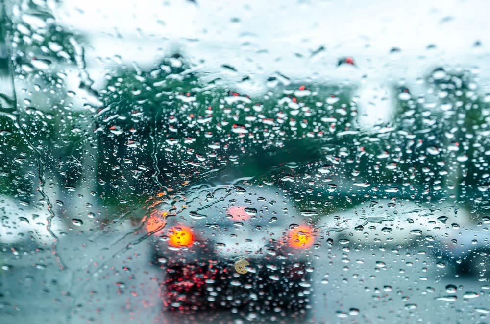 Do I Need Travel Insurance? Is It Worth It? Car stuck in traffic due to bad weather