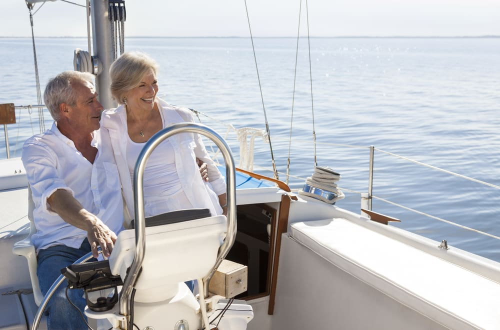 Unconventional travel ideas for all the family in 2019: Mature happy couple sailing in sun