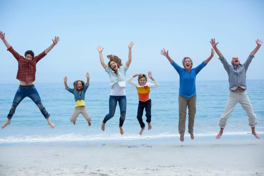 Family jumping for joy on the beach