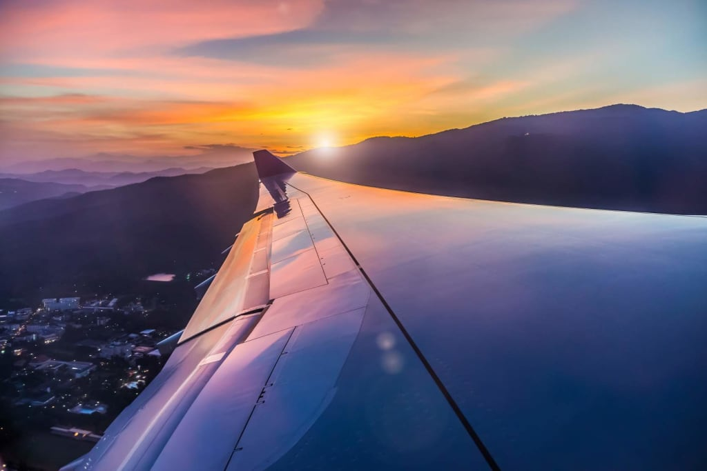 Travelling with breast cancer: View of sunset from plane window