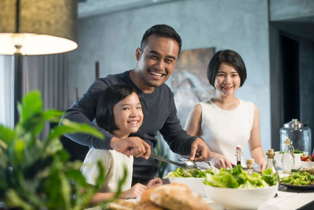 Organic September: Asian family cooking dinner together