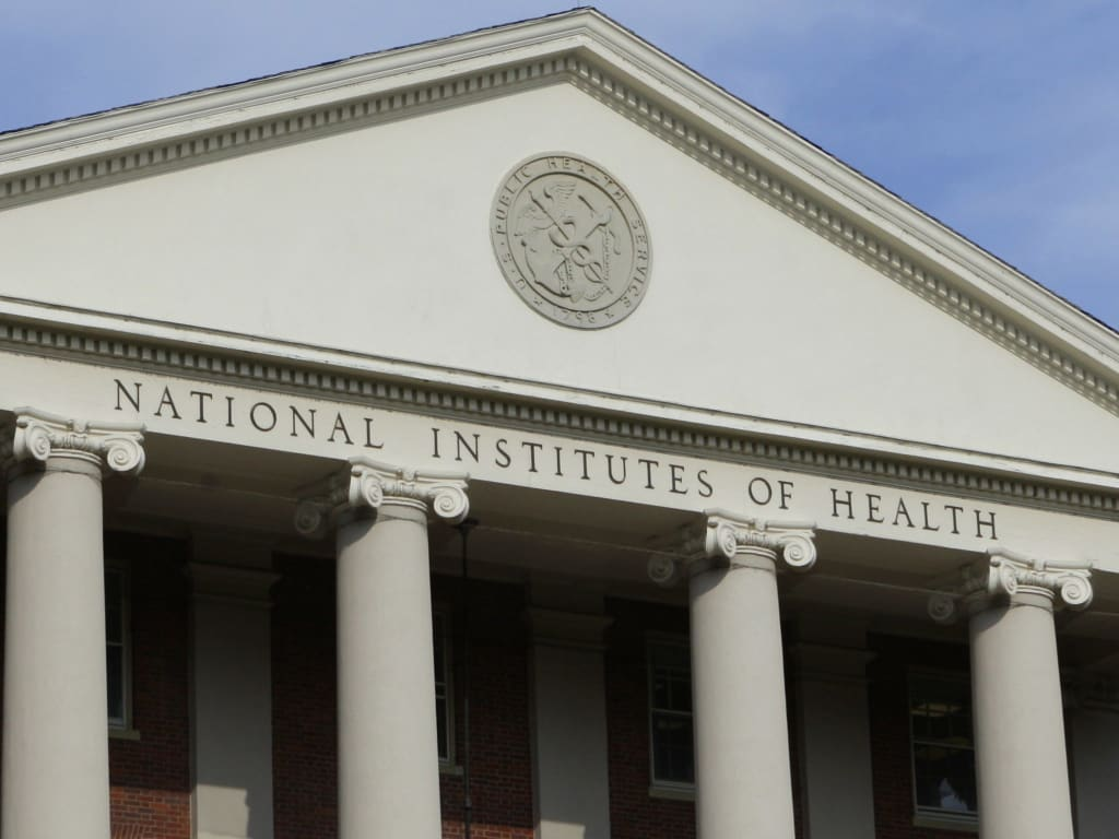The administrative building of the National Institutes of Health is shown in Bethesda, Md., Monday, Aug. 17, 2009. (AP Photo/J. Scott Applewhite)