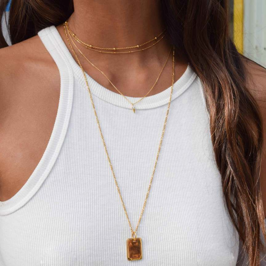 Gold necklace stack