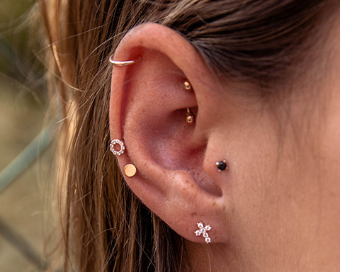 Barbell earrings for pierced ears have a straight bar and screw ball back. Pair with other earrings for a perfectly curated ear stack!