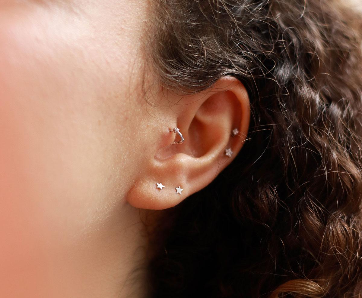 Ear stack of star barbell earrings