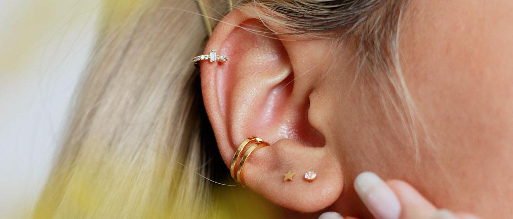 ear cuff and barbell earrings on ear