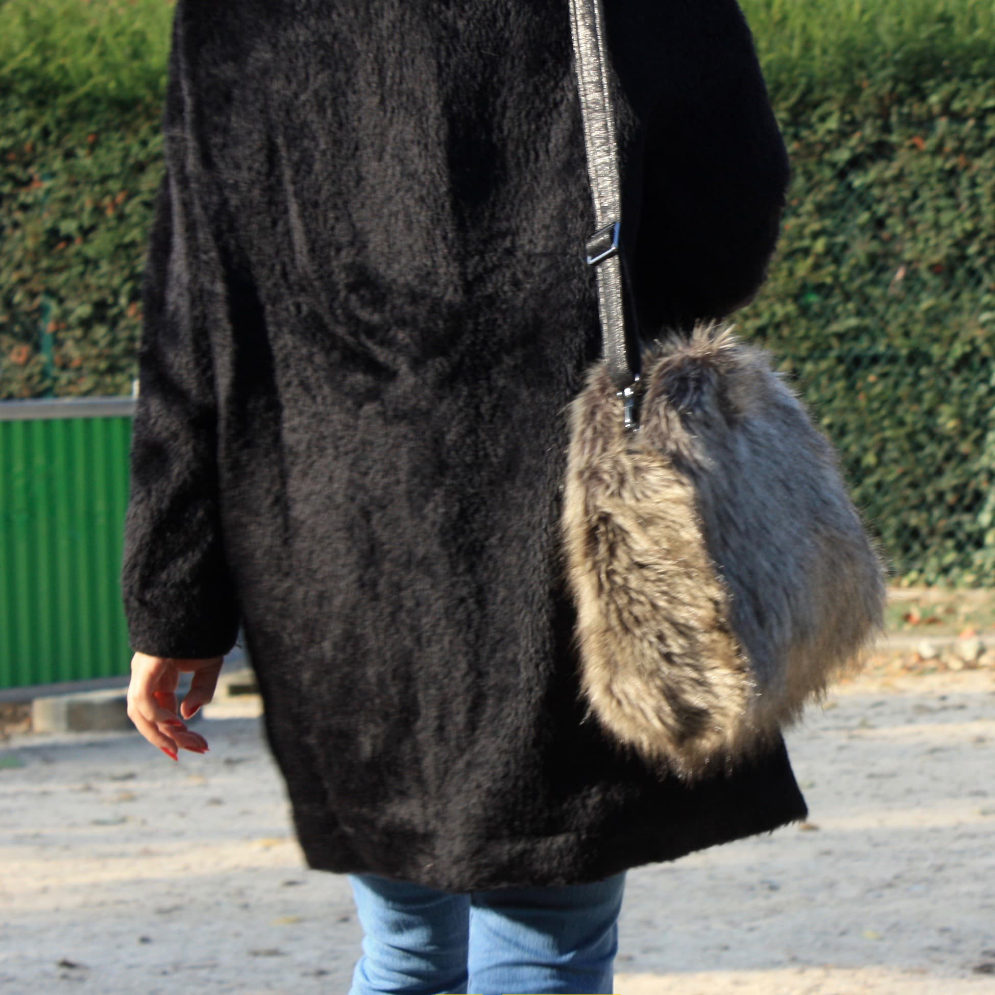 Silver stone fox fur imitation shoulder bag with adjustable and removable strap.