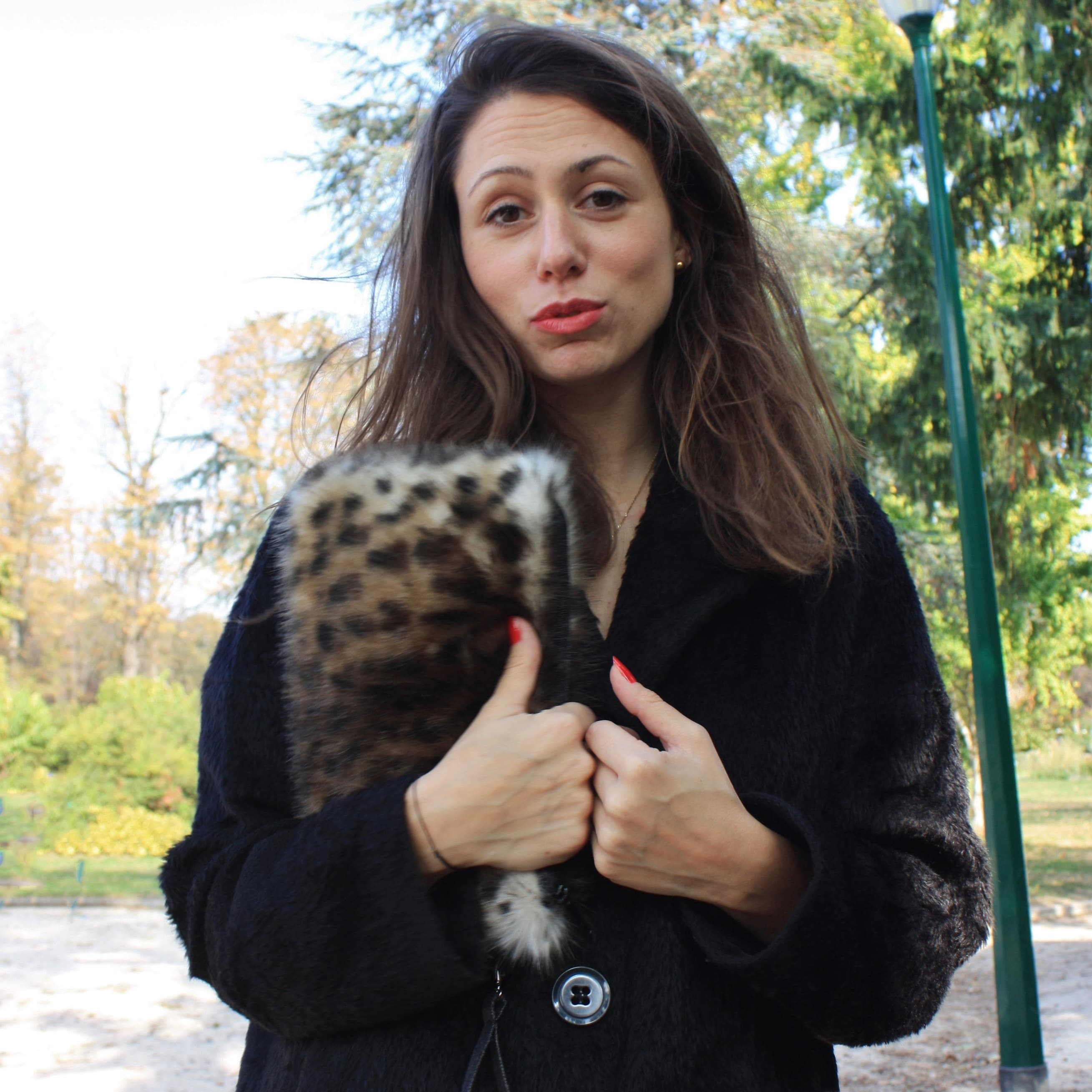 Leopard faux fur clutch bag with removable wrislet.