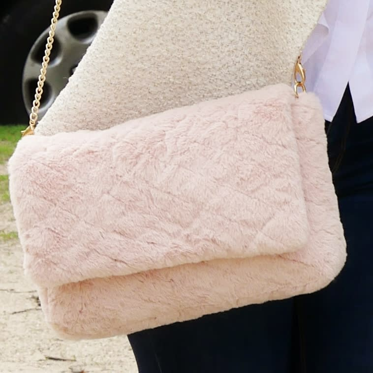 Light pink shoulder bag. Pink padded faux fur crossbody bag.