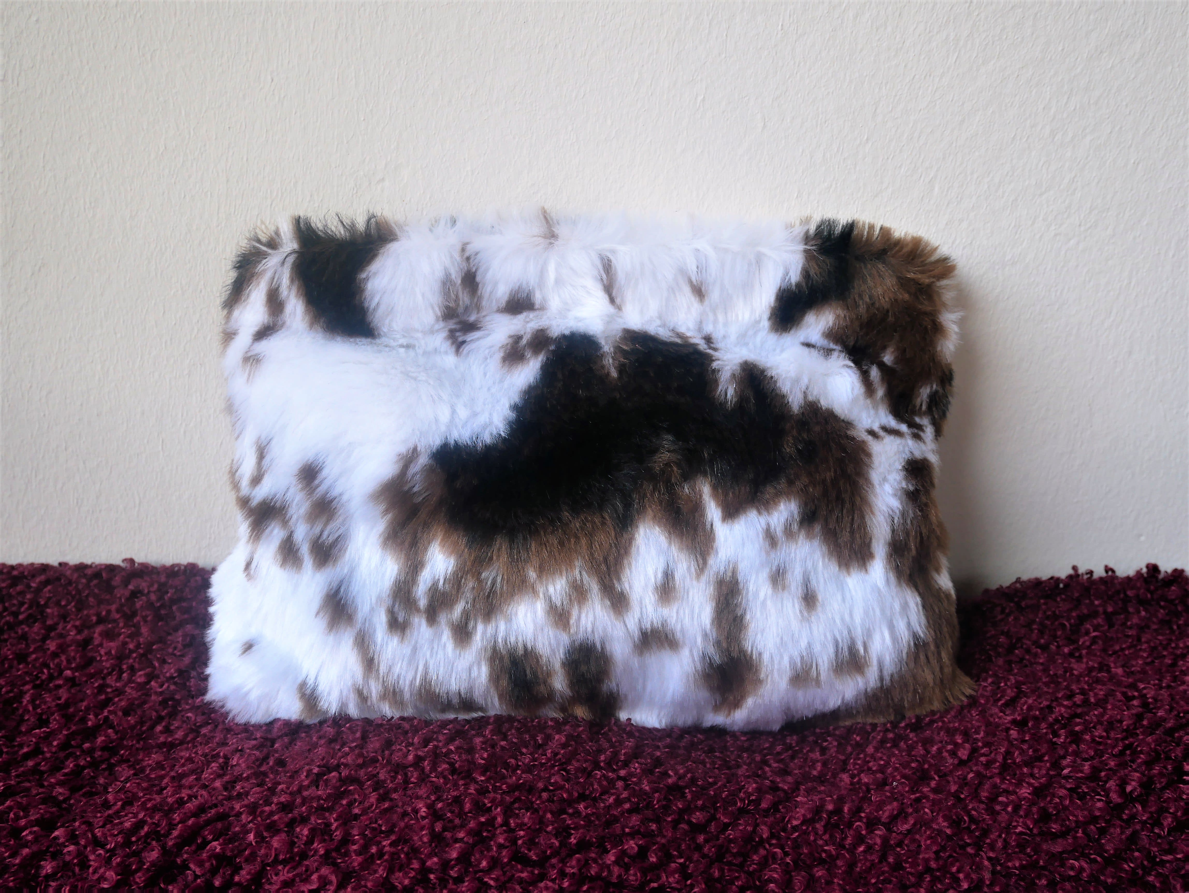 Faux fur purse cow skin design.  Hot fashion faux fur little handbag.