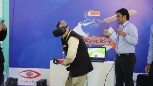 Dr. Lalit Khaitan, Chairman and MD of Radico Khaitan Ltd., experiencing the immersive virtual cricket world.