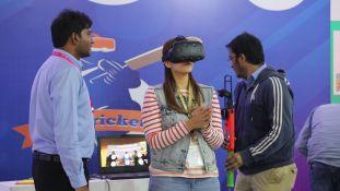 Neha Mahana, daughter of Shri Satish Mahana, experiencing the world of Virtual Reality Cricket.