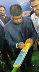 Union IT Minister Shri Ravi Shankar Prasad signing and unveiling the custom made electronic bat used in the sport.