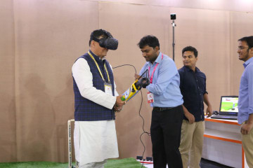 Satish Mahana, Industrial Development Minister, UP taking in the world class immersive VR cricket experience