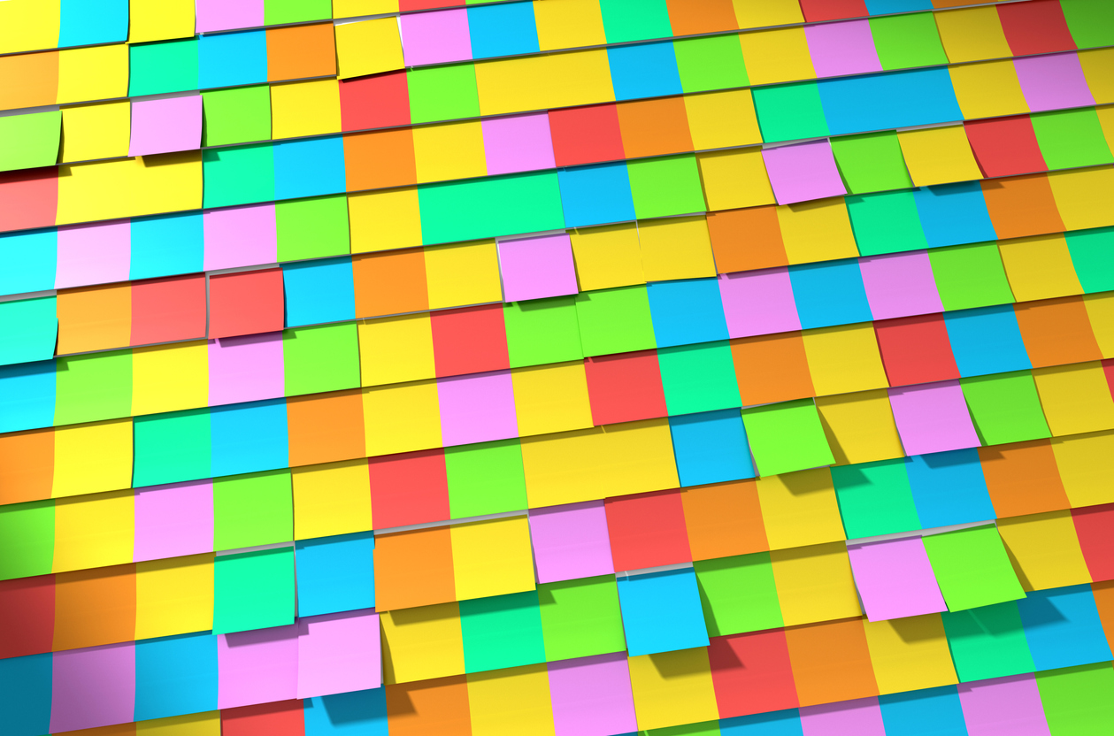 Wall of sticky coloured post it notes