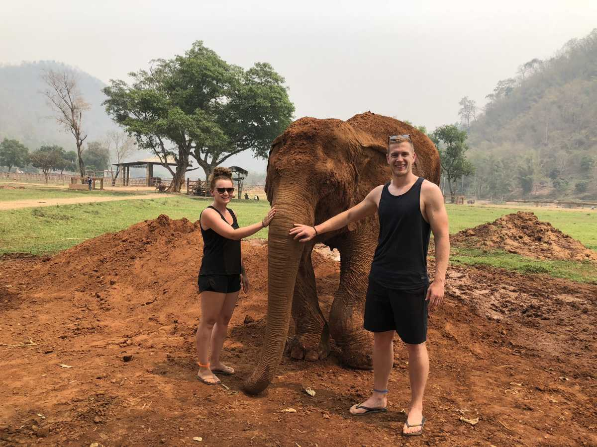 With one of the park's injured elephants