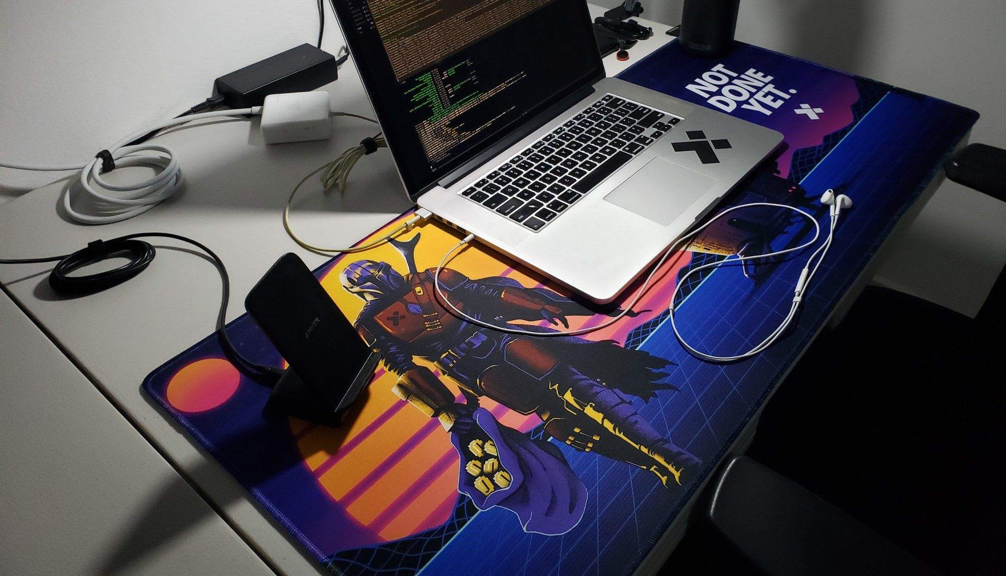 a desktop mat with a smartphone and a laptop on it
