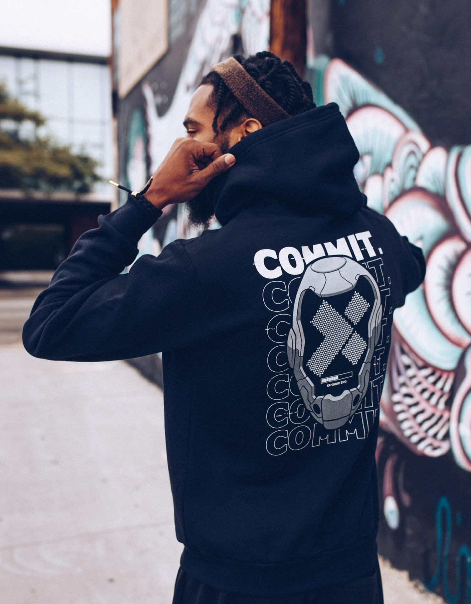 Hoodie with the X-Team logo inside a Daft Punk-esque mask in front of the words COMMIT.