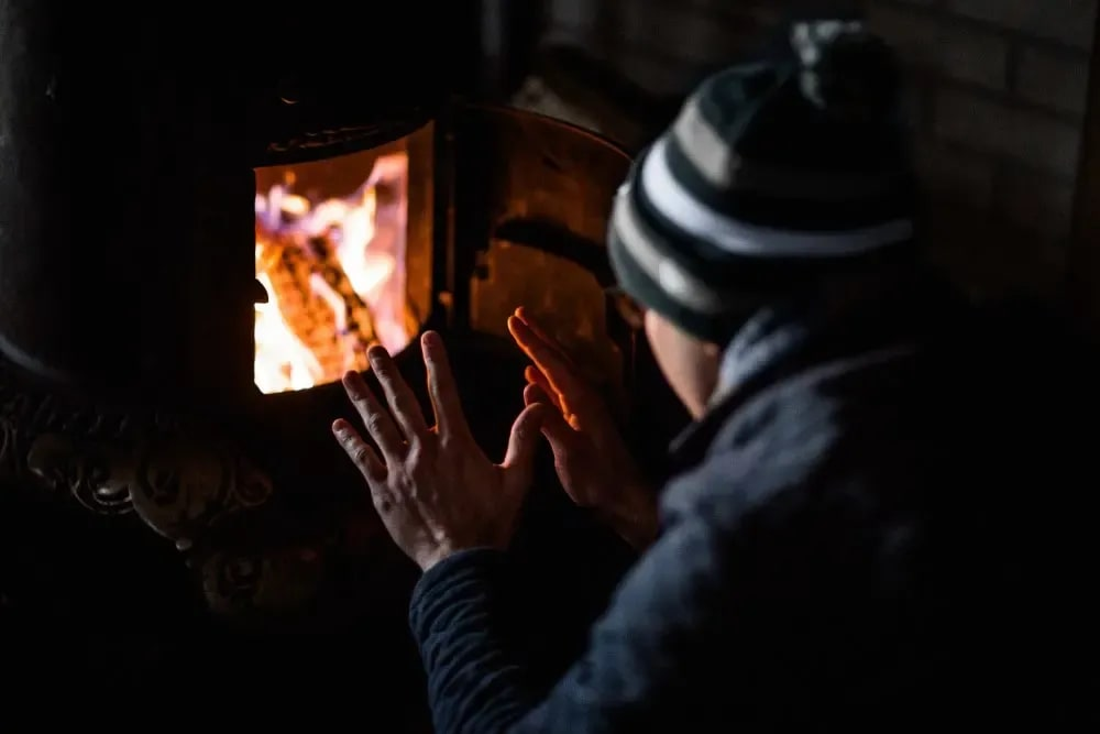 A person warming their hands by a fire