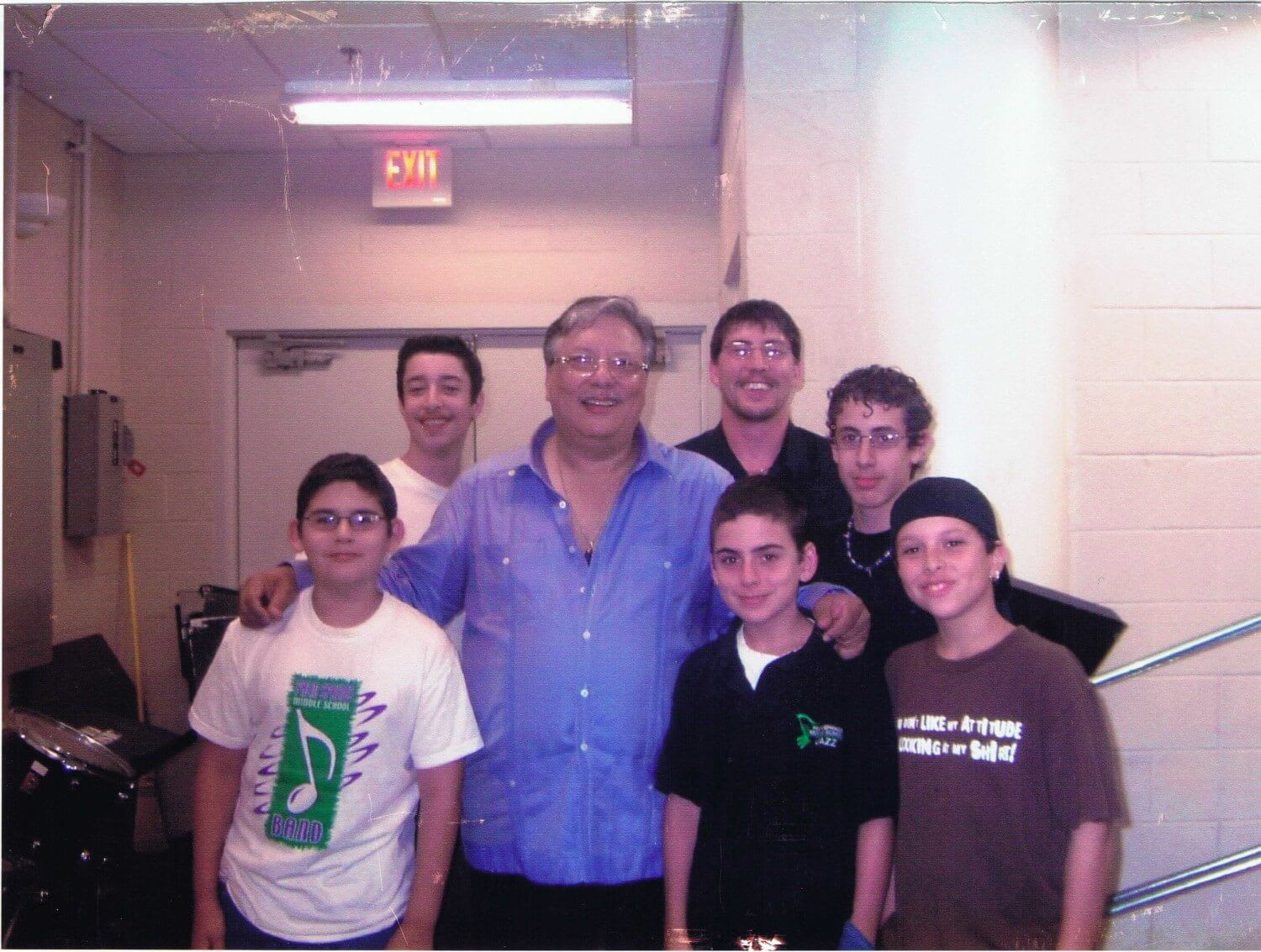 Picture of young boys around Arturo Sandoval