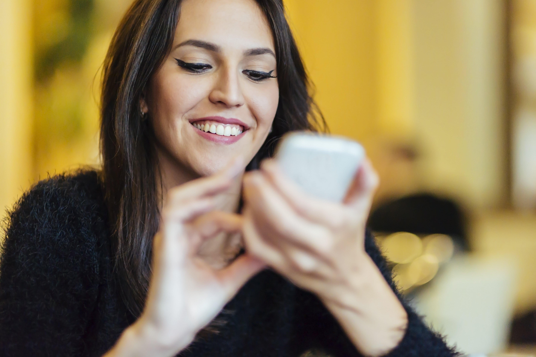 beautiful brunette using phone