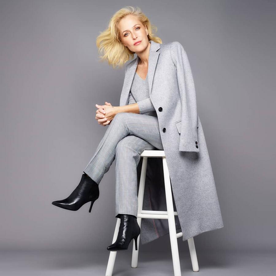 Gillian Anderson wears black boots
